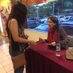 Sarah signing a Jesus Chicks book for a new friend